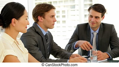Businesswomen shaking hands at interview at the office