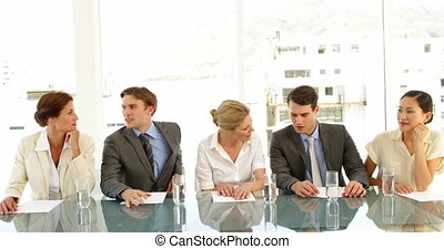 Interview panel discussing scores at the office