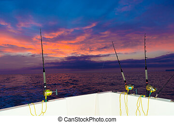 boat fishing trolling at sunset with rods and reels - boat...