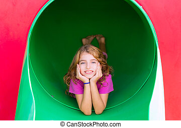 kid girl smiling in the park playground relaxed