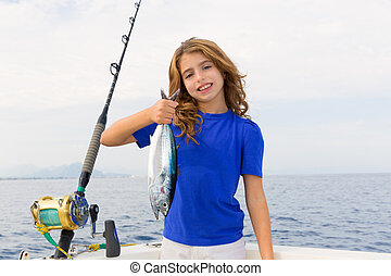 Blond girl fishing bluefin tuna trolling in Mediterranean...