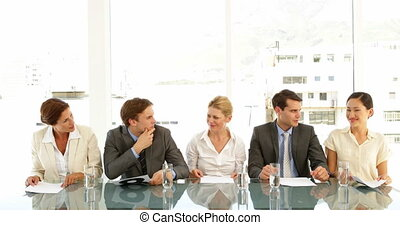 Interview panel holding up scores and smiling at the office