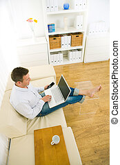 Businessman working at home office - Casual businessman...