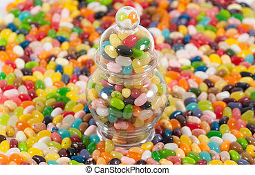 Jellybeans and jar - Jellybeans around a jar full of...