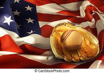 Baseball in glove on American flag
