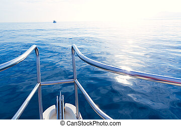 Boat bow sailing in blue calm sea at blue Mediterranean
