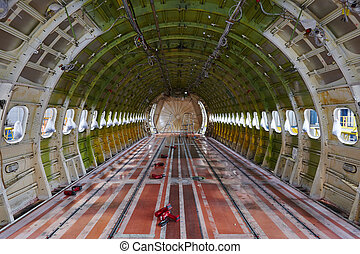 Airplane under maintenance - Cabin of the airplane under...
