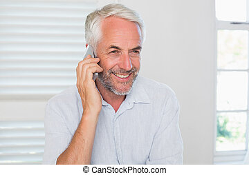 Mature man using mobile phone - Happy mature man using...