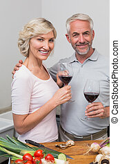 Mature couple with wine glasses in - Loving mature couple...
