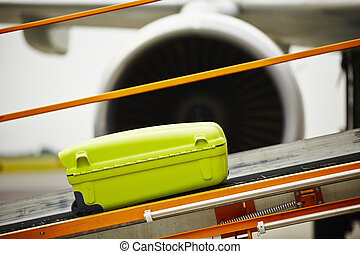 Baggage - The baggage on the conveyor belt to the airplane.