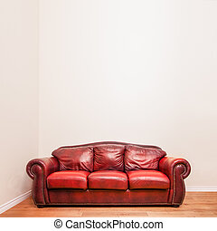 Luxurious Red Leather Couch in front of a blank wall to ad...