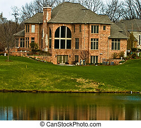 Luxury home on a lake - Brick luxury home on a lake built on...