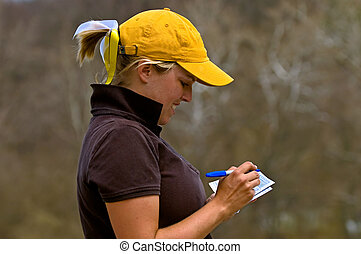 Collegiate golfer adding scorecard - White female collegiate...