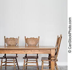 Wooden Dining room table and chair details and blank wall...