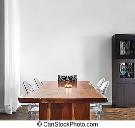 Modern and Contemporary dining room table and decorations. -...