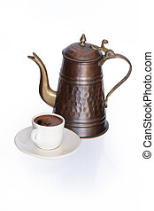 Turkish Coffee - Old brass coffeepot near small cup of black...