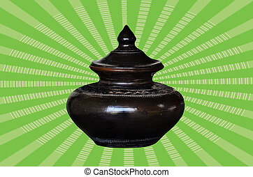 Black clay pot on green vitage background