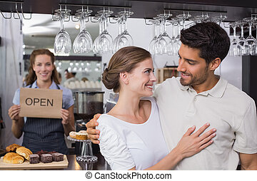 Couple with female cafe owner at coffee shop - Loving couple...