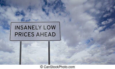 Sign Low Prices Clouds Timelapse - Highway road sign with...