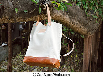 Leather Bags hang on banyan branch - Fashion Leather Bags...