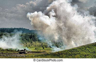 Smoke screen and tank - Russian tank T-80 between smoke...