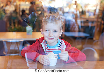 boy eating ice-cream - positive smiling little boy eating...