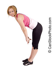 Fitness woman streching - A blond female fitness instructor...