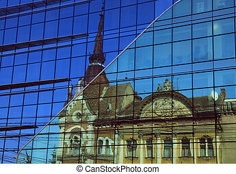 Old & New - Reflection of an old building in a modern blue...