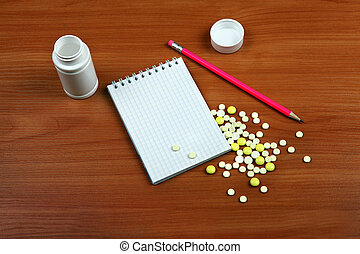 Writing Pad and Pills - Writing Pad and the Pills on the...
