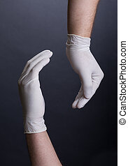 Male hands in latex gloves encircling. Place for a concept.