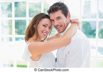 Side view portrait of loving couple at home - Side view...