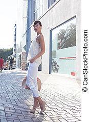 Trendy girl in sunglassesbeige blouse white shirt beige...