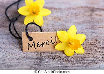 Merci - Label with the French Word merci which means Thanks