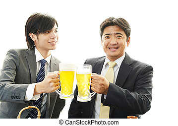 Men drinking beer - The male office workers who poses...