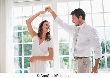 Loving couple dancing at home - Loving young couple dancing...