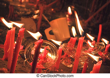 Light though red candles