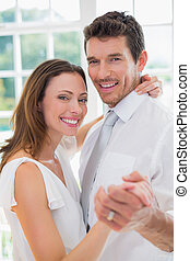 Happy loving couple dancing at home - Portrait of a happy...