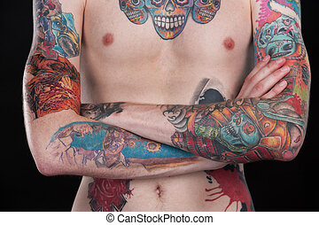 colorful tattoo chest of young man tattoo covered body with...
