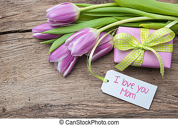 i love you mom - fresh tulips and tag on wooden background