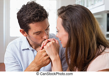 Loving man kissing womans hand at home - Close-up of a...