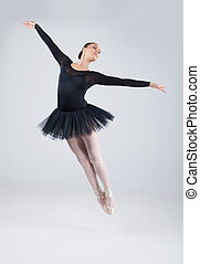 attractive dancer jumping and practicing dance. beautiful...