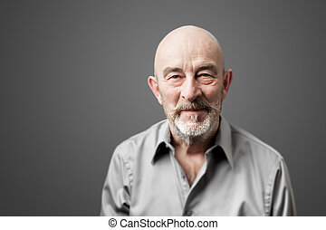 senior man with beard - An image of a senior man with a...