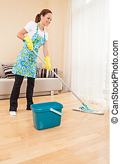 closeup of woman doing housework and cleaning beautiful girl...