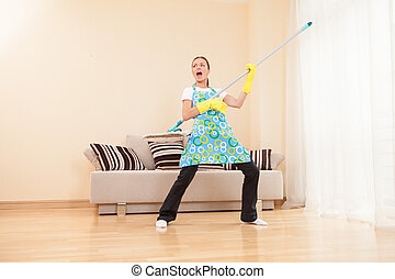 funny woman mopping floor and playing. beautiful girl...