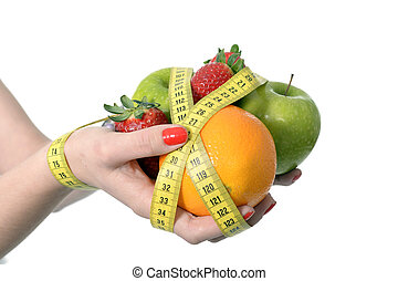 woman hands with fruit bond with measure tape slave to diet...