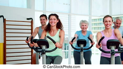 Fitness group doing a spinning class at the gym