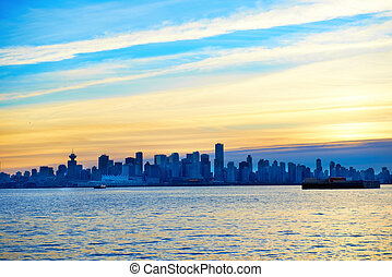 Sunset above Vancouver, Canada - Night city, panoramic scene...