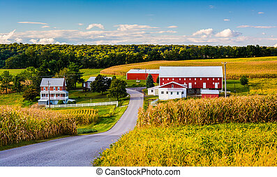 Red barn and house along a country road near Winterstown,...