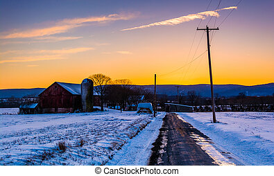 Barn and snow covered fields along a country road in rural Frederick County, Maryland.