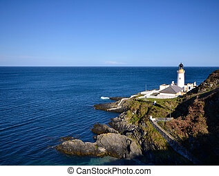 Douglas Lighthouse on the Isle of Man with sea on sunny day